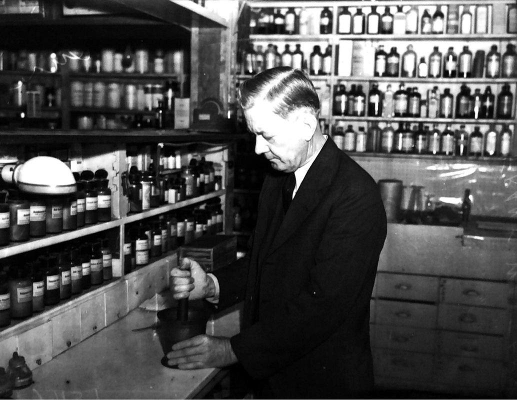 Druggist Frank Walters uses a 107 year old copper mortar and pestle, 1937 | Drink up the history with The Barwalk, San Antonio TX