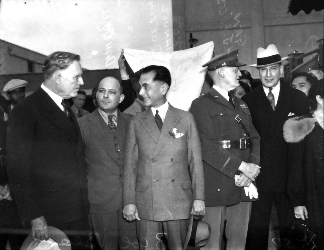 Filipino President Manuel Quezon visits San Antonio, flanked by mayor Charles Quin, Postmaster Dan Quill, Quezon, General Herbert Brees, and General Douglas MacArthur in fedora and suit. | Drink up the history with The Barwalk, San Antonio TX